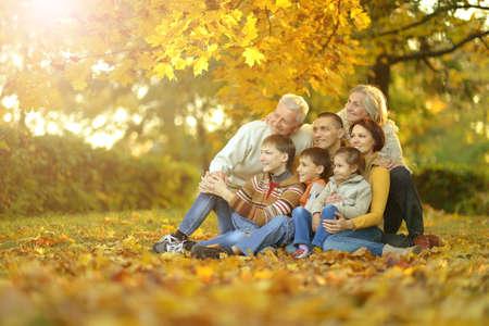 Photo pour Big family having fun together in autumnal park - image libre de droit