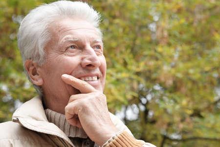 Photo pour Portrait of happy senior man in park - image libre de droit