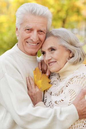 Photo pour Beautiful senior couple embracing in the park - image libre de droit
