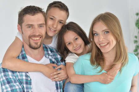 Photo pour Portrait of happy family posing at home - image libre de droit