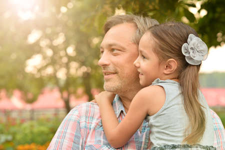 Photo pour Portrait of happy father and daughter hugging outdoors - image libre de droit