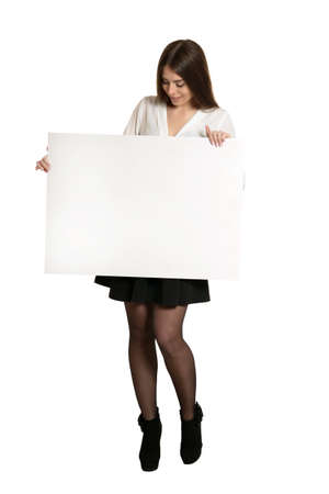 Photo for Beautiful woman and white signboard ard or copyspace for slogan or text - Royalty Free Image