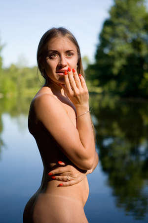 Foto de Emotional portrait of a naked girl in an open air. Human and nature. - Imagen libre de derechos