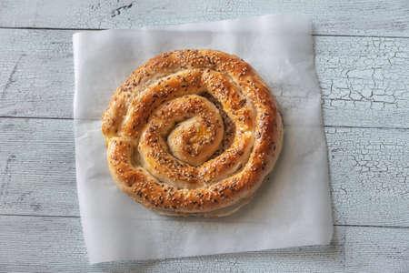 Photo pour Spiral phyllo pie with feta flat lay - image libre de droit