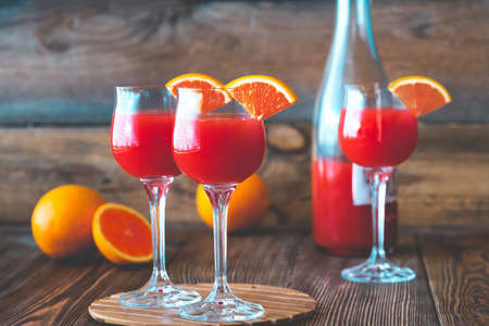 Photo for Three glasses of Mimosa cocktail on the wooden - Royalty Free Image