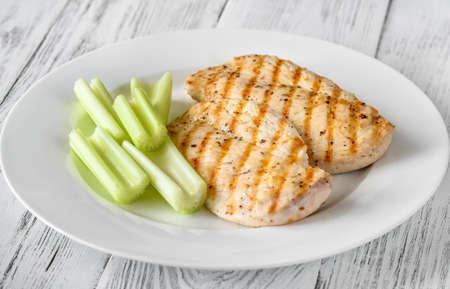 Photo pour Grilled chicken garnished with celery stalks - image libre de droit