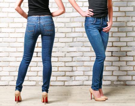Foto de Slim Woman Wearing Blue Skinny Jeans. Back and Side View - Imagen libre de derechos