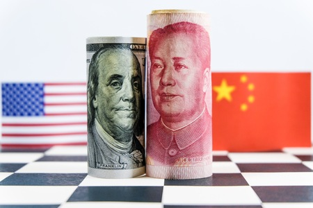 Photo for America dollar and Yuan banknote with USA and China flags. Its is symbol for tariff trade war crisis between biggest economic country in the world. - Royalty Free Image