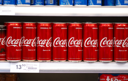 BANGKOK, THAILAND - MAY 23, 2019: Coca-Cola logo printed on aluminium can and placed on shopping mall. Coca-Cola is a carbonated soft drink sold in stores and restaurants throughout the world.