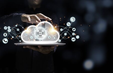 Foto de Businessman holding tablet with artificial intelligence virtual cloud computing and business icon. Cloud technology management for big data include business strategy , customer service. - Imagen libre de derechos