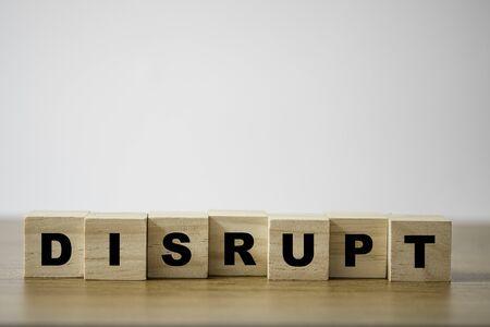 Photo pour Disrupt wording print screen on wooden cubes block on table. - image libre de droit
