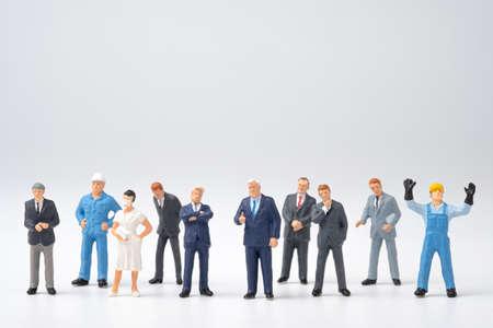 Photo pour Different occupation job in people group , Miniature figure on white background. - image libre de droit