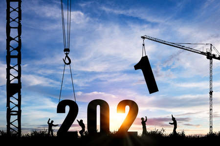 Photo pour Silhouette of construction worker with crane under prepare welcome 2021 new year party and change new business. - image libre de droit