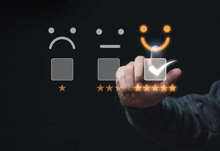 Photo for Customer satisfaction survey concept, Businessman touching smiley face icon with yellow five stars and correct mark to evaluate product and service. - Royalty Free Image