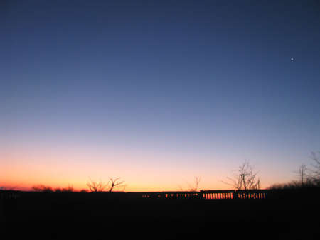Photo pour The Morning Star Venus Sparkles In The Pink Rays Of The Rising Sun - image libre de droit