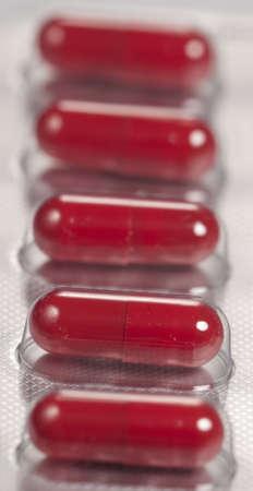 capsulas in blister over light background, macro shot