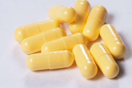 Capsules of antibiotic over light background, macro shot