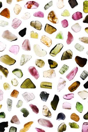 Photo pour Tourmaline different color jewel stone texture on white background. Macro closeup. - image libre de droit