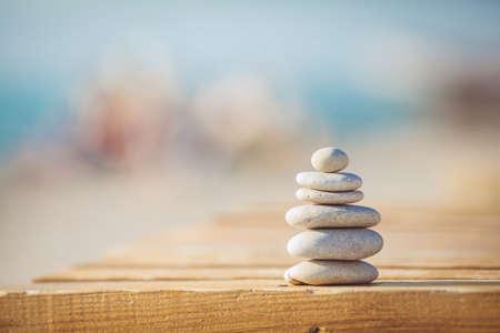 zen stones jy wooden banch on the beach near sea  Outdoor