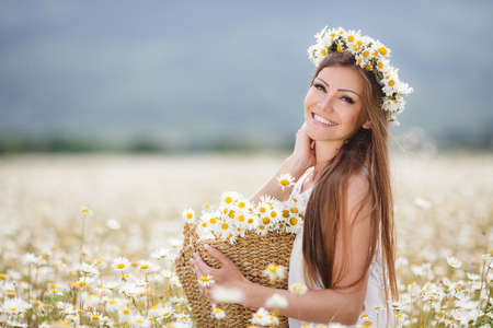 Beautiful woman enjoying daisy fieldの写真素材