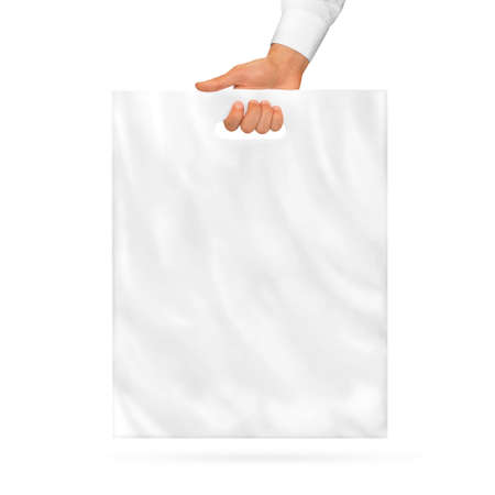 Photo pour Blank plastic bag mock up holding in hand. Empty polyethylene package mockup hold in hands isolated on white. Consumer pack ready for logo design or identity presentation. Product food packet handle. - image libre de droit
