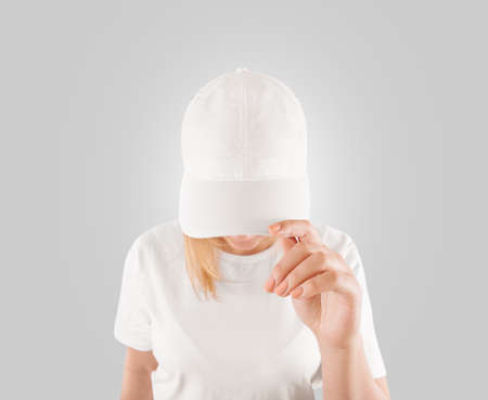 Foto de Blank white baseball cap mockup template, wear on women head, isolated - Imagen libre de derechos