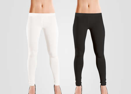 Woman wear blank leggings mockup, black, white, isolated on grey. Women in clear leggins template. Cloth pants design presentation. Sport pantaloons stretch tights model wearing. Slim legs in apparel.