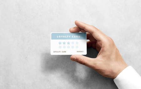 Foto de Hand hold discount card template with rounded corners. Plain reward namecard mock up holding arm. Plastic loyalty program mockup with points display. Gift offset card design. Loyal service branding. - Imagen libre de derechos
