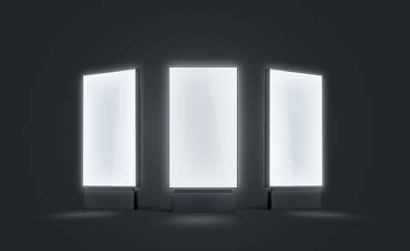 Blank white glowing pylon mock up set, isolated in darkness, 3d rendering. Empty illuminated screen mock up, different sides. Clear luminous poster for ad or affiche. Outdoor lightbox template.