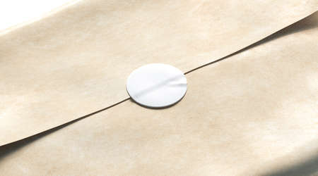 Foto de Blank white adhesive round sticker on craft wrapping paper mockup, 3d rendering. Empty delivery pack with glue stick mock up. Clear product crumpled package with badge template. - Imagen libre de derechos
