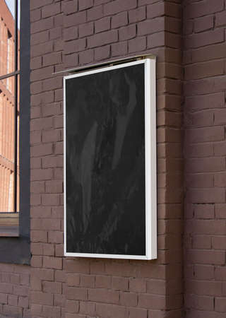 Photo pour Blank black glass rectangular poster mock up brick wall mounted - image libre de droit