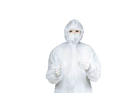 Photo for A woman in a protective suit, gloves and mask uses a DNA test tube and a cotton swab, wipe the test isolated on a white background with copy space and advertising space. - Royalty Free Image