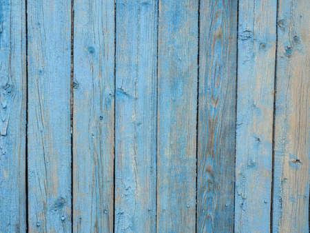 Photo pour Old wooden planks covered with peeling blue paint. - image libre de droit