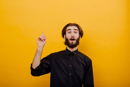 Photo for Thinking man having idea. evrika,  Closeup portrait intelligent  young man who just came up with an idea aha, isolated yellow background. Positive emotion facial expression feeling, attitude, perception - Royalty Free Image