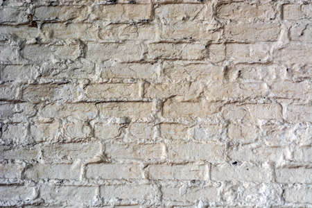 background of a brick wall painted with white paint.
