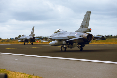 Schleswig - Jagel, Germany - June 19, 2014: Two Netherlands - Air Force General Dynamics F-16A Fighting Falcon is taxiing on the strip of airbase Schleswig