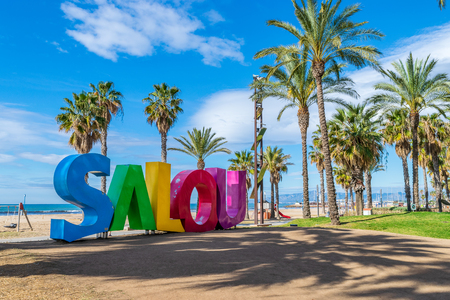 Photo pour A big colorful Salou sign at the sea coast in Salou city, Tarragona - image libre de droit