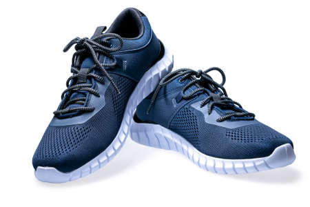 Photo pour Pair of new dark blue sneakers isolated on white background. - image libre de droit