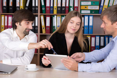 Group of People discussing Business Subject at Office