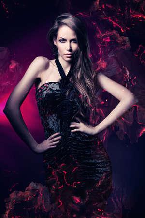 Foto de sexy woman in black dress on dark magenta background - Imagen libre de derechos