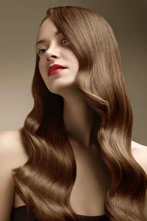 Photo pour Woman with perfect hair on blue background - image libre de droit