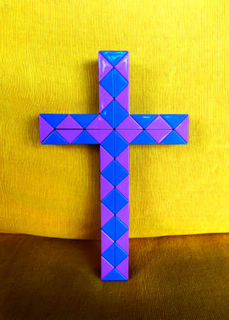 Plastic purple and blue christian cross