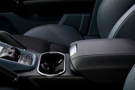 Auto interior detail. Leather armrest.