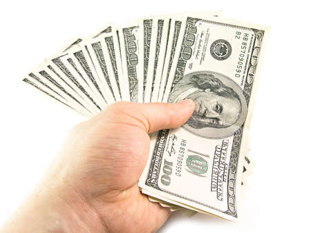 The isolated hundred dollar denominations in a hand