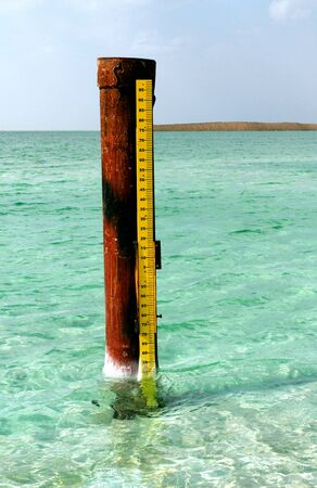 Photo pour Dead Sea, is a salt lake bordering Jordan to the north, and Israel to the west. Its surface and shores are 430.5 metres 1,412 ft below sea level. Dead Sea water meter - image libre de droit