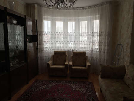 Photo pour A typical living room in Russia. A carpet, an old sideboard, armchairs - all this is found in almost every apartment in the post-Soviet space. - image libre de droit
