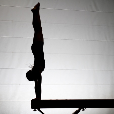 silhouette of gymnast on balance beam