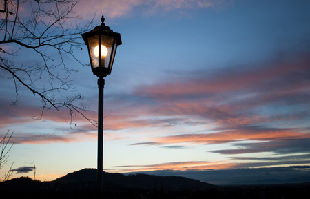 old lamps shining in sunset sky