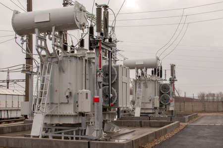 Photo for High voltage transformers in an electrical substation. Side view. Selective focus. - Royalty Free Image