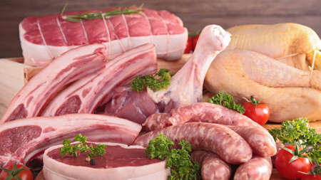 Photo for Set of raw meat chicken and sausages close-up background - Royalty Free Image